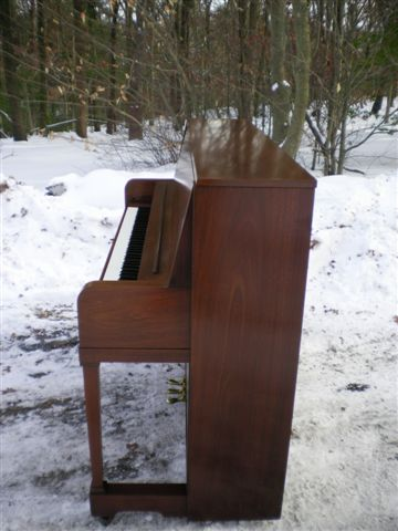 (SOLD)Everett Studio Walnut Upright Sold By Steinway $1700.